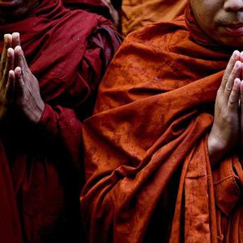 An NHS trust has hired a Buddhist monk to give happiness classes to staff