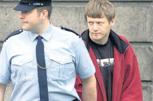 Larry Murphy is led away in 2001 after pleading guilty to kidnap and rape