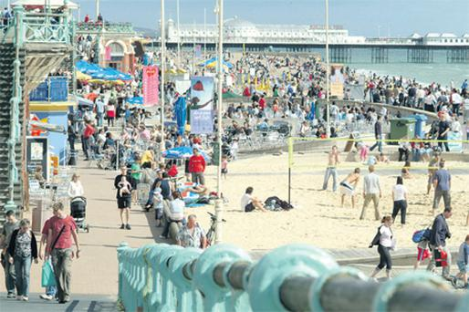 Brighton beachfront buzzes in high summer with locals and visitors