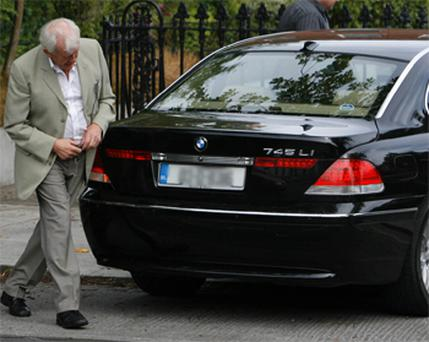 Paddy Kelly pictured at his Morehampton Road home last week with the BMW car returned by the Dublin City Sheriff. Photo: Kyran O'Brien