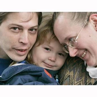 Heath Campbell, left, with his wife, Deborah, right, and son Adolf Hitler Campbell (AP)