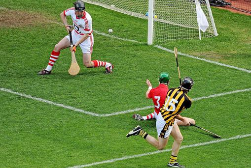 Aidan Fogarty fires Kilkenny's second goal past Donal Og Cusack in the Cork goal and defender Eoin Cadogan. Photo: Brendan Moran / Sportsfile