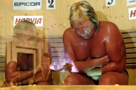 Vladimir Ladyzhenskiy with Timo Kaukonen just before Mr Ladyzhenskiy collapsed and died during the World Sauna Championships in Finland