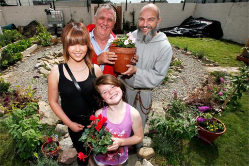 Tommy Daly of the Moyross Residents Alliance with Br Paulus of the Franciscan Friars, Stephanie Bennet and Rebecca Loughnan at the opening of a community garden in Moyross, Limerick, yesterday