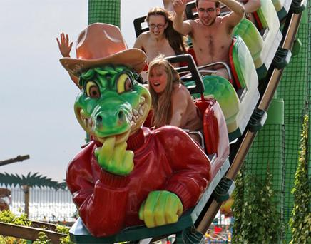 Thrill seekers ride naked on the Green Scream roller coaster at Southend pleasure park. Photo: PA