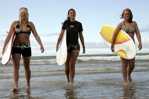 Surf instructor Lorna Walshe, Emer Kelly and Grace Doyle getting ready for the Tramore Oceanic Surf and Sea Festival