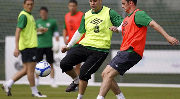Shay Given playing outfield with Keith Treacy (right) during yesterday's training session in Malahide. Photo: PA