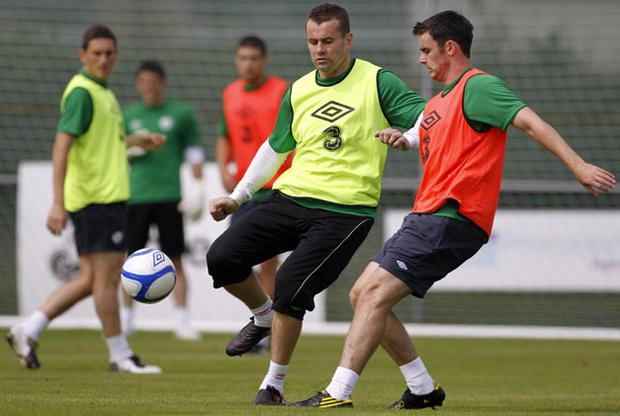 Goalkeeper Shay Given playing outfield with Keith Treacy (right) during a training session with Ireland