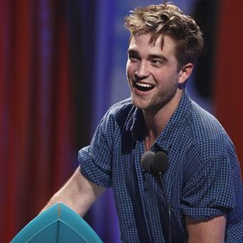 Robert Pattinson picked up two of 12 Teen Choice Awards for Twilight