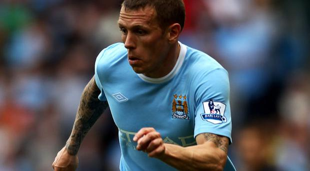 Craig Bellamy faces an uncertain future at Eastlands and is by no means certain to be named in manager Roberto Mancini's squad. Photo: Getty Images