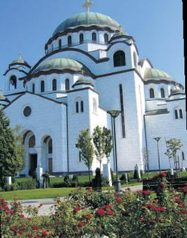 The colossal dome of the Orthodox Temple of St Sava is visible across the city.