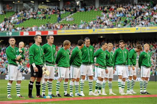 Robbie Keane with his son Robbie Jnr on to the pitch to line out with the Ireland team at Lansdowne Road