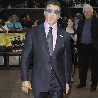Sylvester Stallone has topped a poll of action heroes