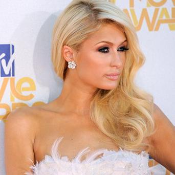 A hair extensions manufacturer is suing Paris Hilton for allegedly wearing someone else's hair