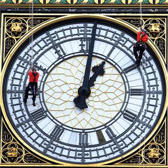 Abseilers examine the face of the Great Clock