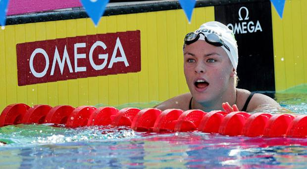 Grainne Murphy looks up to check her time after missing out on a bronze medal in the final of the women's 800m freestyle by five hundredths of a second yesterday.