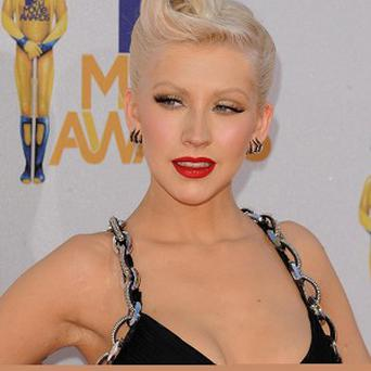 Christina Aguilera is helping to raise money for the arts