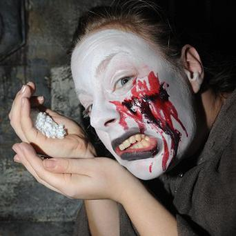Emma Liversidge spills salt as part of the mass superstition bashing event at York Dungeon