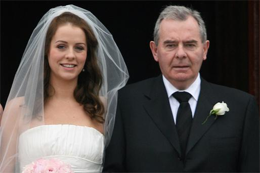 Businessman Sean Quinn and his daughter Aoife at St Mary's Church, Belturbet