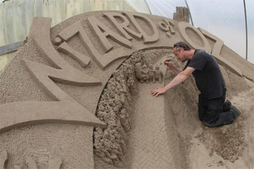 Artist Daniel Doyle creating a sand sculpture at the annual Duncannon Sand Sculpture festival