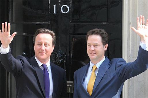 David Cameron (left) with his deputy Nick Clegg, who will act as his stand-in while Cameron takes a holiday and paternity leave