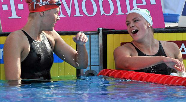 Grainne Murphy (right) chats with gold medal winner Lotte Friis after claiming silver in the final of the Women's 1500m Freestyle at the European Championships.