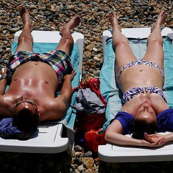 Men do not want their partners sunbathing topless, according to a poll