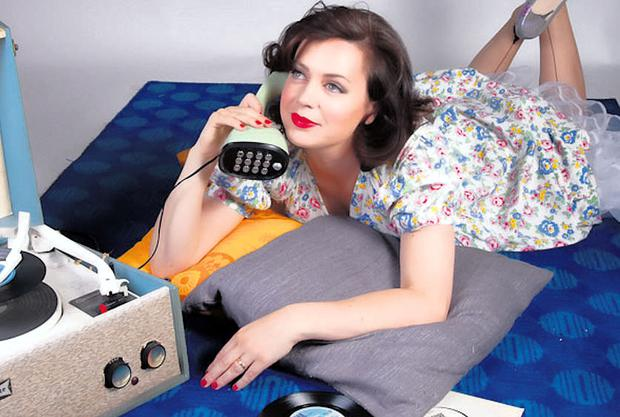 Fifties flower dress, €25, underskirt, model's own, stockings, model's own, stiletto shoes, €20. Dansette record player, €95. Erico telephone, €75
