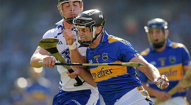Paul Curran, Tipperary, in action against Eoin Kelly, Waterford
