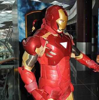 Superheroes like Iron Man are sending out the wrong message to susceptible young boys, say researchers