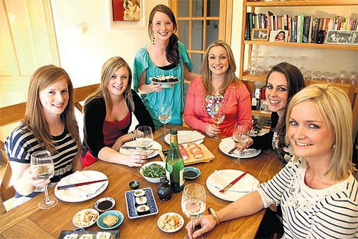 Laura Kenny (centre) gets her friends to pitch in and make sushi