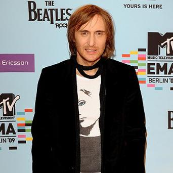 David Guetta is just as lively in the studio as he is on stage