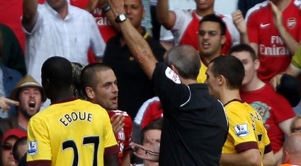 Referee Martin Atkinson shows a red card to Joe Cole. Photo: Getty Images