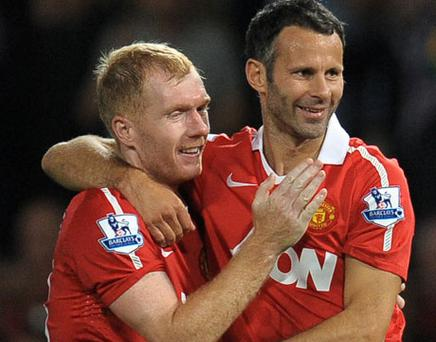Hugs all round: Paul Scholes and Ryan Giggs embrace after United beat Newcastle 3-0. Photo: Getty Images