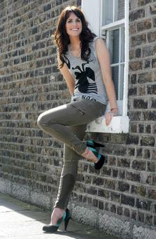 HOLLY WEARS Left, olive-green cargo trousers, €58, Topshop; grey T-shirt, €75, Twenty8Twelve