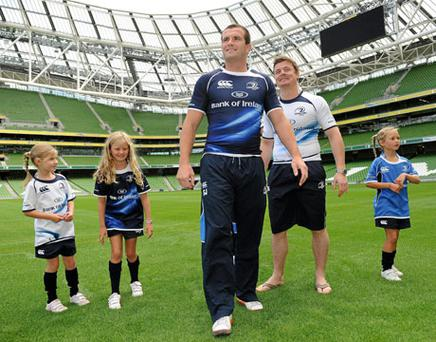 Shane Jennings and Brian O'Driscoll with (from left) Sophie Quinn, Lia Quinn and Ella Quinn at yesterday's announcement that Leinster will play Munster and Clermont at Aviva Stadium this season. Photo: Brendan Moran / Sportsfile