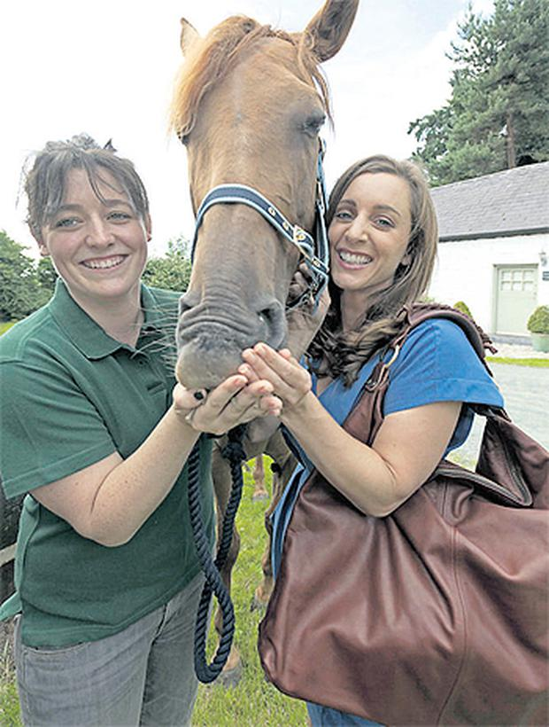 Louise O'Leary (left), of Louloubelle Bags, and Sinead Desmond of TV3, model the 'Hazel' bag, named after Louise's rescued thoroughbred mare