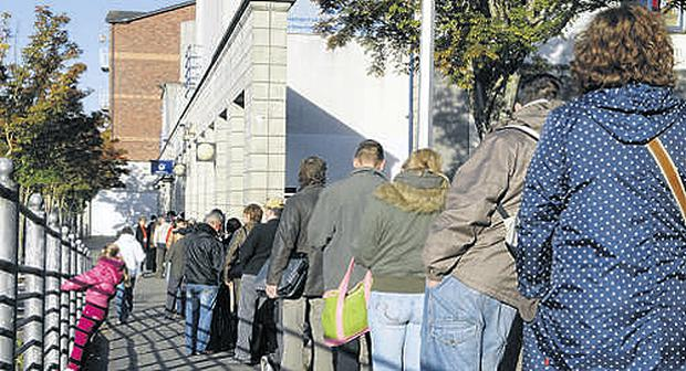 The unemployment rate has risen to 12.8pc, typified by this queue at a dole office in Cork city