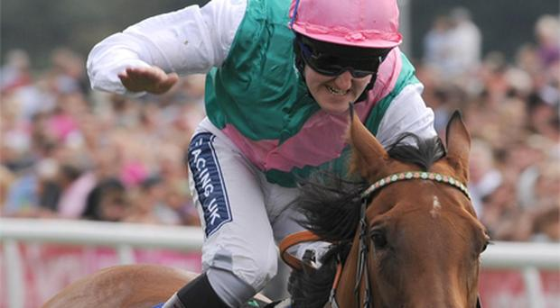 Jockey Tom Queally pats Midday as they cross the line to win the Yorkshire Oaks