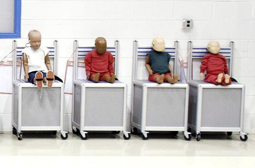 Child-sized crash-test dummies are displayed at Takata's current crash-testing facility in Auburn Hills, Michigan