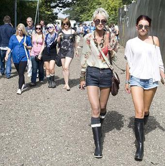 Festival goers arrive at Hylands Park in Chelmsford, Essex, for the V Festival