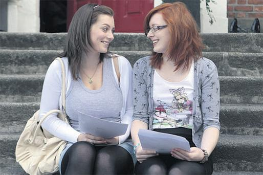 SMILES ALL ROUND: Catherine King (right) is congratulated by her friend Aisling O'Neill Halligan as she celebrates getting 8 A1 grades in her Leaving Certificate exams outside Loreto College, Dublin