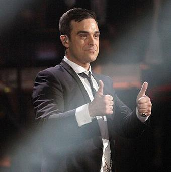 Some male drivers like singing along to Robbie Williams in their cars