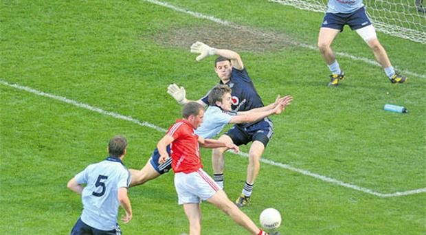 Cork's Patrick Kelly kicks a point against Dublin late in the game. Photo: Sportsfile