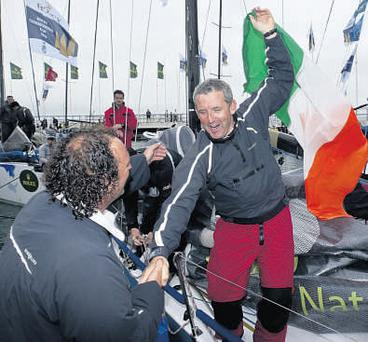 Tom Murphy, crew member on marinerscove.ie, celebrates with Maurice 'Prof' O'Connell (right) who was a member of the crew on Roxy 6 after Ireland claimed the Commodores' Cup at Cowes at the weekend. Photo: David Brannigan