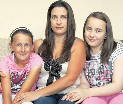 Carol Cody pictured with two of her children, Carolyn (10) and Michaela (11), at her home in Kilkenny. Photo: Dylan Vaughan