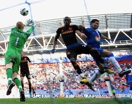 Salomon Kalou scores Chelsea's fifth goal against Wigan on Saturday. Photo: Getty Images