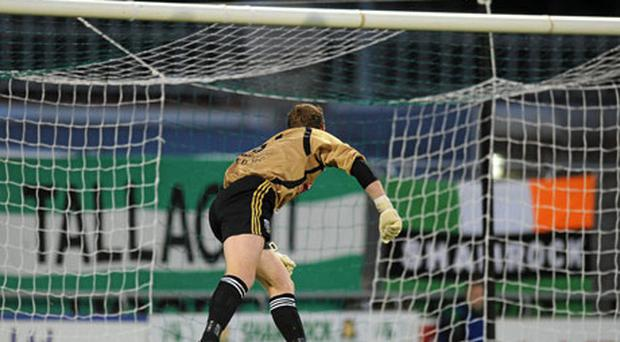 UCD goalkeeper Gerard Barron watches the ball hit the net after a shot from Shamrock Rovers' Billy Dennehy went in for his side's second goal in Tallaght last night. Photo: David Maher / Sportsfile
