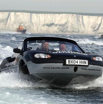 Sir Richard Branson making a successful attempt on the record for crossing the English Channel in an amphibious vehicle