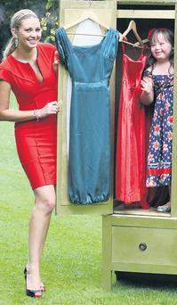 Anna Daly of TV3 and Clara Lewis (7) from Cabinteely, Co Dublin play dress-up in St Stephen's Green, Dublin, at the launch of buymydressonline.ie. JAMES HORAN/COLLINS PHOTOS